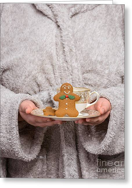 Bathrobe Greeting Cards - Holding Gingerbread Greeting Card by Amanda And Christopher Elwell