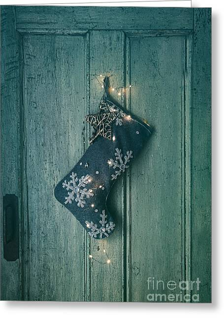 Greens Greeting Cards Greeting Cards - Holiday stocking with lights hanging on old door Greeting Card by Sandra Cunningham