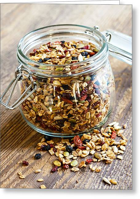 Toast Photographs Greeting Cards - Homemade granola in glass jar Greeting Card by Elena Elisseeva