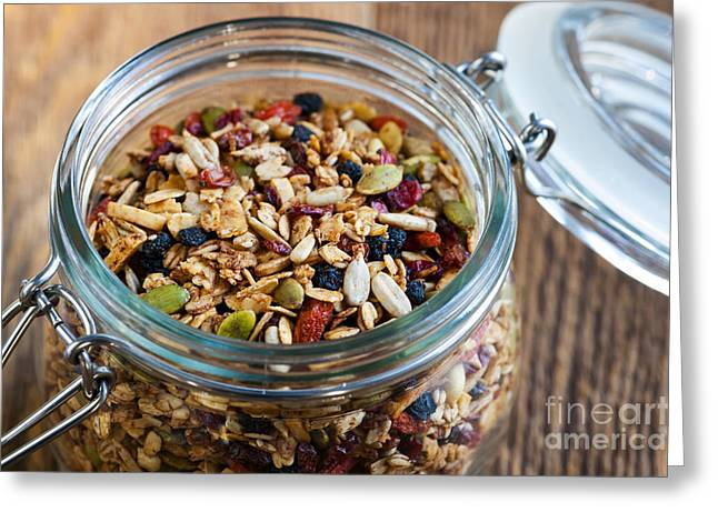 Toast Photographs Greeting Cards - Homemade granola in open jar Greeting Card by Elena Elisseeva