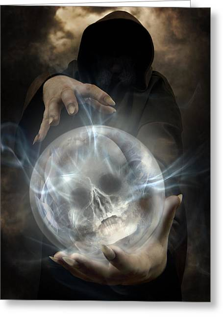 Hooded Man Wearing Dark Cloak Holding Glowing Crystall Ball With Human Skull Image Inside Greeting Card by Jaroslaw Blaminsky