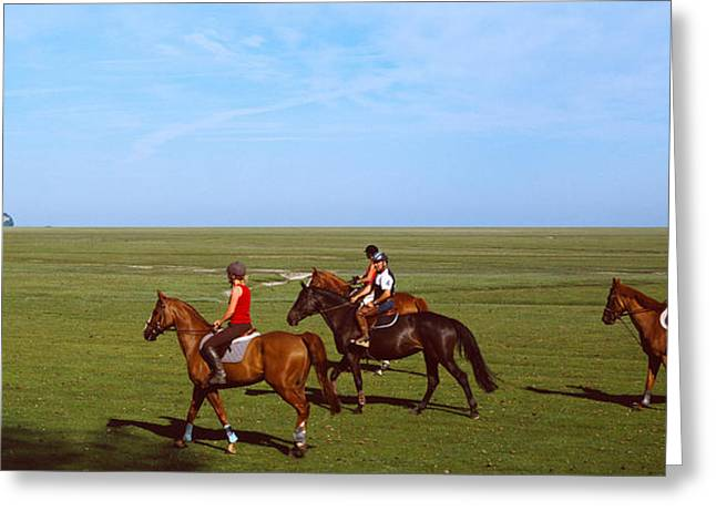 Horseback Photographs Greeting Cards - Horseback Riders In A Field With Mont Greeting Card by Panoramic Images