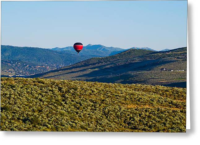 Mid-air Greeting Cards - Hot Air Balloon Flying In A Valley Greeting Card by Panoramic Images