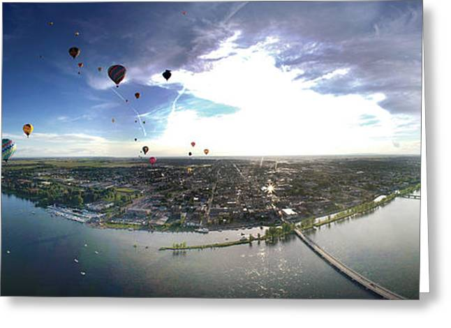 Mid-air Greeting Cards - Hot Air Balloons Flying Over A River Greeting Card by Panoramic Images