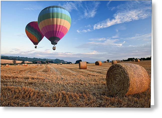Hot Air Balloons Over Hay Bales Sunset Landscape Greeting Card by Matthew Gibson