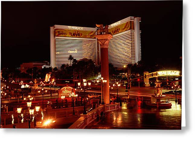 Mirage Greeting Cards - Hotel Lit Up At Night, The Mirage, The Greeting Card by Panoramic Images