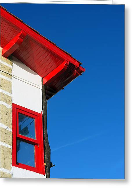 Old Frame Houses Greeting Cards - House facade with red roof and window against blue sky Greeting Card by Mikel Martinez de Osaba
