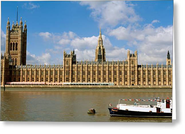 Historic England Greeting Cards - Houses Of Parliament, Water And Boat Greeting Card by Panoramic Images