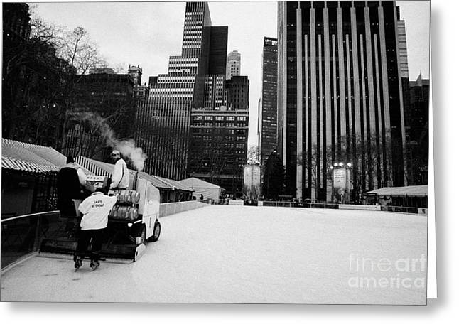 ice clearer and assistants clearing the ice at Bryant Park ice skating rink new york Greeting Card by Joe Fox