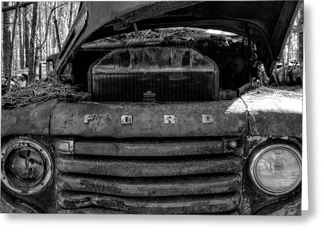 Old Trucks Greeting Cards - In Front of an Old Rusty Ford Truck in Black and White Greeting Card by Greg Mimbs