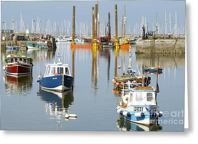 Boats In Reflecting Water Greeting Cards - In The Middle Greeting Card by Wendy Wilton