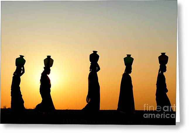 Indian Ethnicity Greeting Cards - Indian Women Carrying Water Pots At Sunset Greeting Card by Tim Gainey