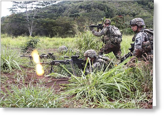 Brigade Greeting Cards - Infantryman Fires A Burst Greeting Card by Stocktrek Images