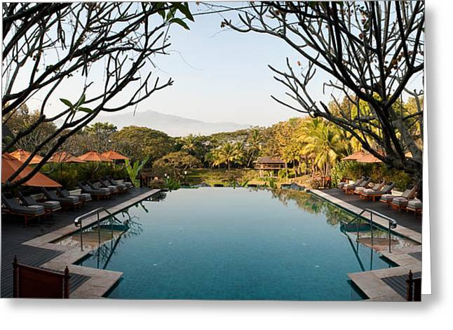Tourist Resort Greeting Cards - Infinity Pool In A Hotel, Four Seasons Greeting Card by Panoramic Images