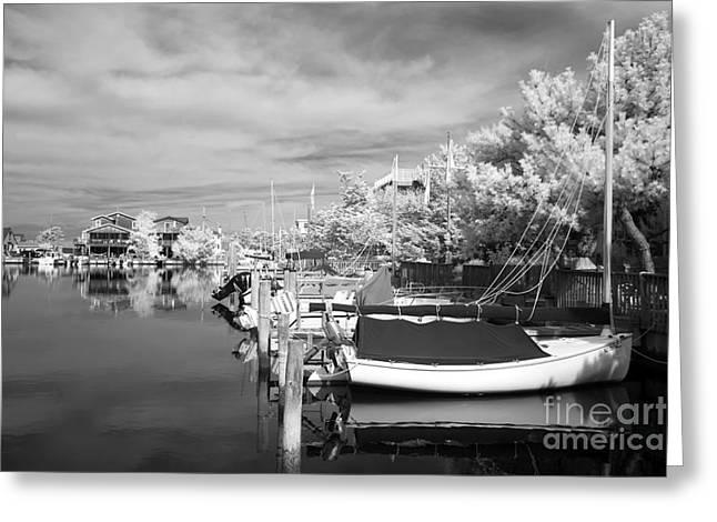 Boats At The Dock Photographs Greeting Cards - Infrared Boats at LBI bw Greeting Card by John Rizzuto