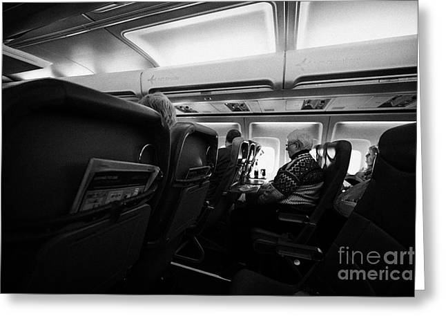Cabin Interiors Photographs Greeting Cards - Interior Of Jet2 Aircraft Passenger Cabin In Flight Europe Greeting Card by Joe Fox