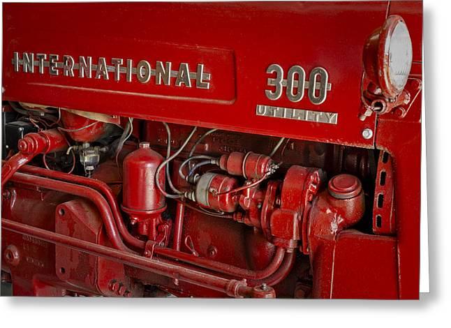 International 300 Utility Harvester Greeting Card by Susan Candelario