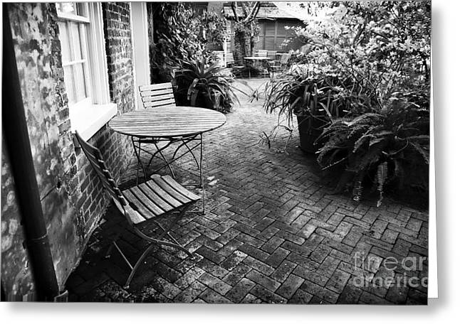 Patio Table And Chairs Photographs Greeting Cards - Into the Courtyard Greeting Card by John Rizzuto