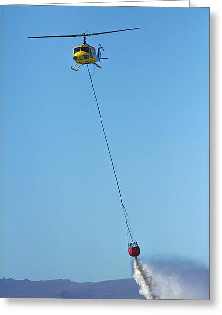 Iroquois Helicopter With Monsoon Greeting Card by David Wall
