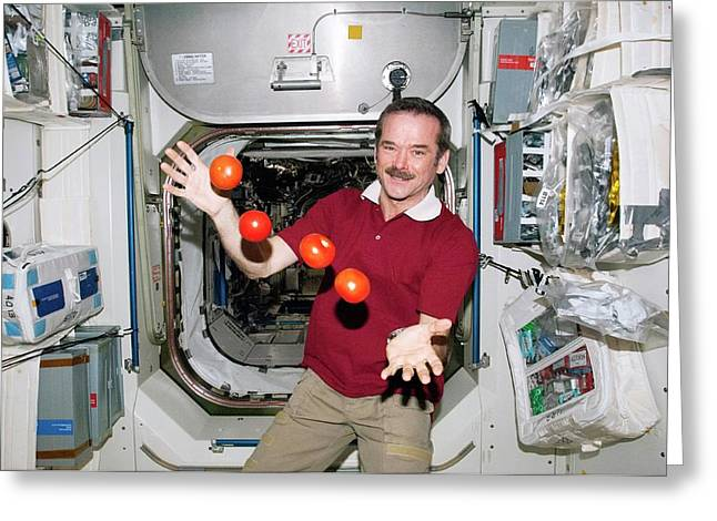 Iss Astronaut Juggling Greeting Card by Nasa