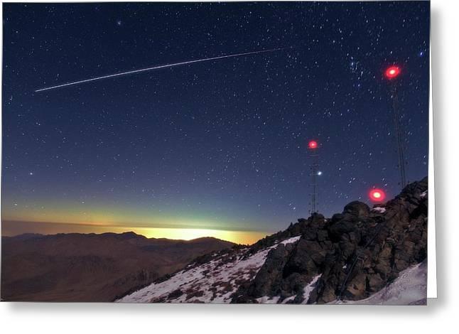 Iss Crossing The Night Sky Greeting Card by Babak Tafreshi