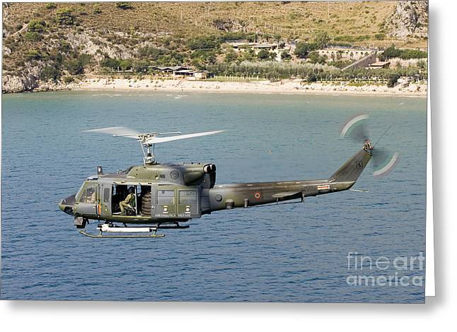 On The Beach Greeting Cards - Italian Air Force Ab-212 Ico Helicopter Greeting Card by Erik Roelofs
