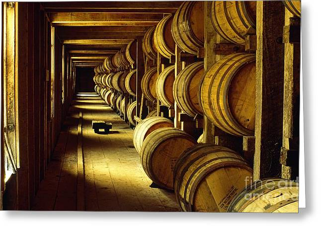 Distillery Greeting Cards - Jack Daniel whiskey maturing in barrels in old warehouse at the Lynchburg distillery Tennessee USA Greeting Card by David Lyons