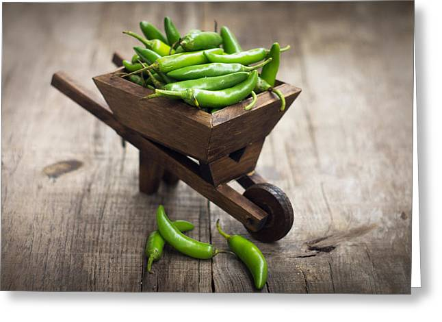 Jalapenos Chili Pepper In A Miniature Wheelbarrow Greeting Card by Aged Pixel