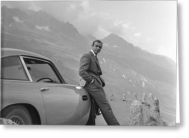 Vintage Images Greeting Cards - James Bond and his Aston Martin Greeting Card by Nomad Art And  Design