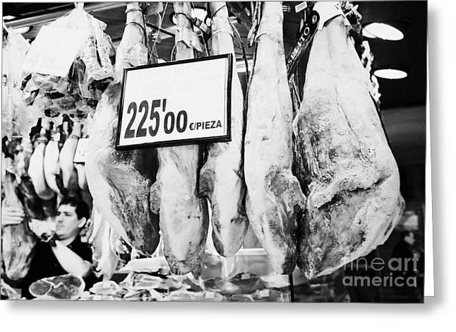 Fresh Produce Greeting Cards - jamon iberico hams hanging inside the la boqueria market in Barcelona Catalonia Spain Greeting Card by Joe Fox