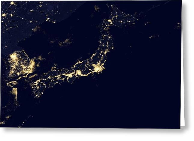 City Lights Greeting Cards - Japan at night, satellite image Greeting Card by Science Photo Library
