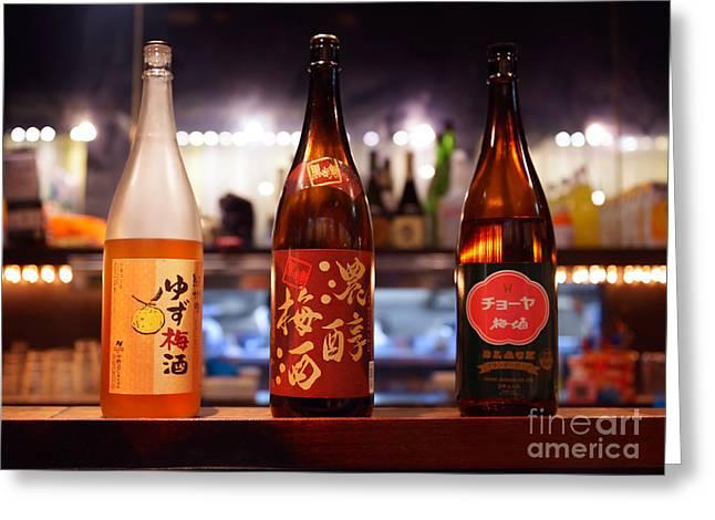 Sake Bottle Greeting Cards - Japanese sake bottles in a bar Greeting Card by Oleksiy Maksymenko