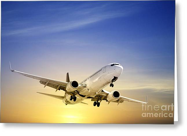 Aeroplane Greeting Cards - Jet Aeroplane Landing at Sunset Blue Yellow  Greeting Card by Colin and Linda McKie