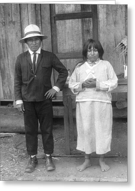 Husband Waiting Greeting Cards - Jivaro Headhunter And HIs Wife Greeting Card by Underwood Archives
