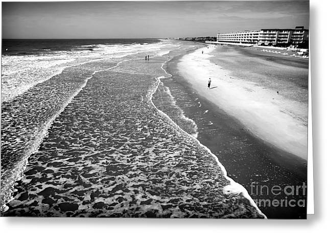 Jogging Photographs Greeting Cards - Jogging at Folly Beach Greeting Card by John Rizzuto