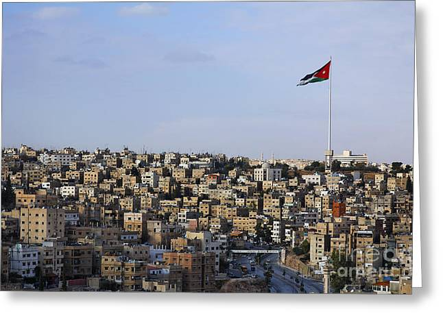 Jordanian Greeting Cards - Jordanian flag flying over the city of Amman Jordan Greeting Card by Robert Preston