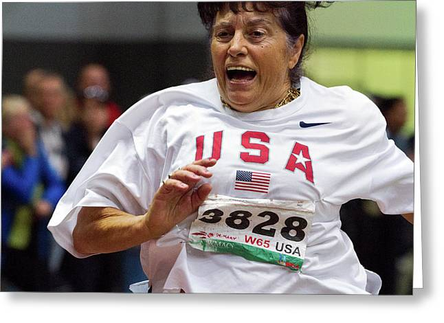 Joyful Older Female Athlete Running Greeting Card by Alex Rotas
