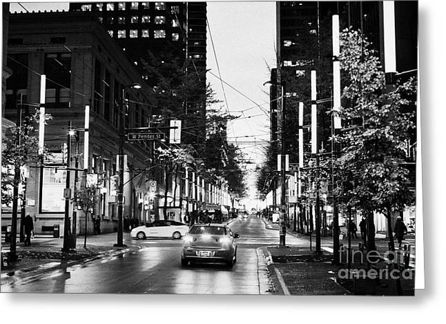 Evening Scenes Greeting Cards - junction of west pender street and granville downtown city at night Vancouver BC Canada Greeting Card by Joe Fox