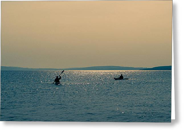 Sea Kayak Greeting Cards - Kayaking into the sunset Greeting Card by Kai Bergmann