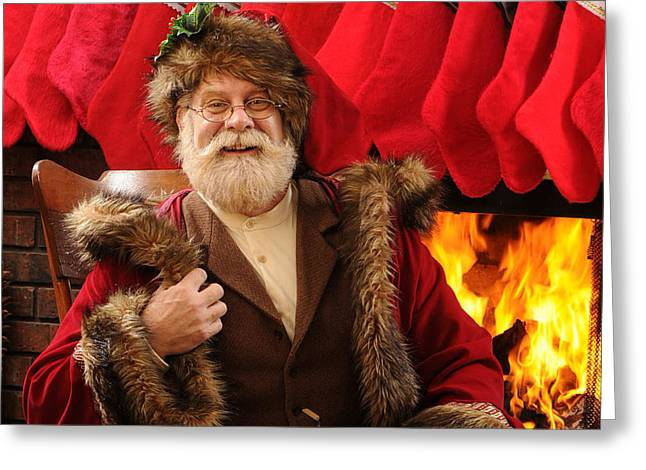 Old Saint Nick Greeting Cards - Keeping Warm Greeting Card by Don Wolf