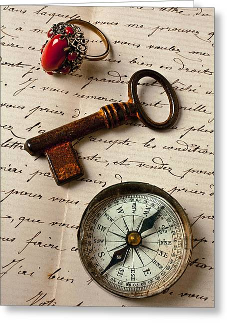 Rings Greeting Cards - Key ring and compass Greeting Card by Garry Gay