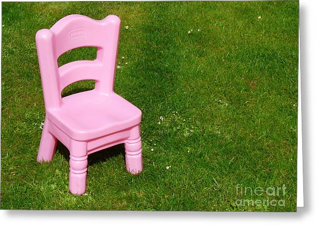 Kids Chair Greeting Cards - Kids Pink chair on green grass Greeting Card by Patrick Dinneen