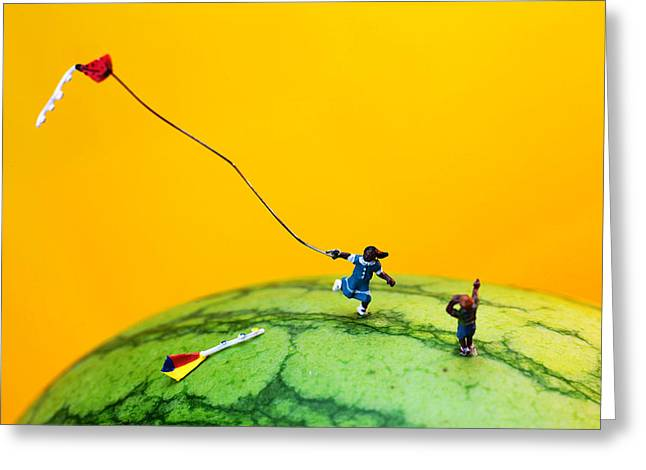 Watermelon Greeting Cards - Kite runner on watermelon Greeting Card by Paul Ge