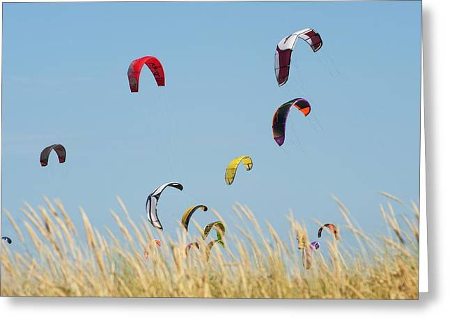 Kite Boarding Greeting Cards - Kites Of Kite Surfers In Front Of Hotel Greeting Card by Ben Welsh