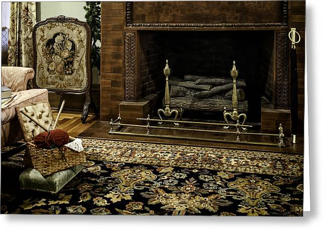 Knitting In Front Of A Vintage Fireplace Greeting Card by Lynn Palmer
