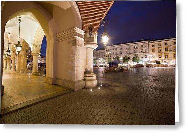 Polish Old Town Greeting Cards - Krakow Old Town in Poland at Night Greeting Card by Artur Bogacki