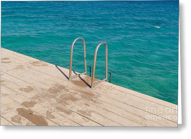 Swim Ladder Greeting Cards - Ladder on a wooden bridge Greeting Card by Nikita Buida