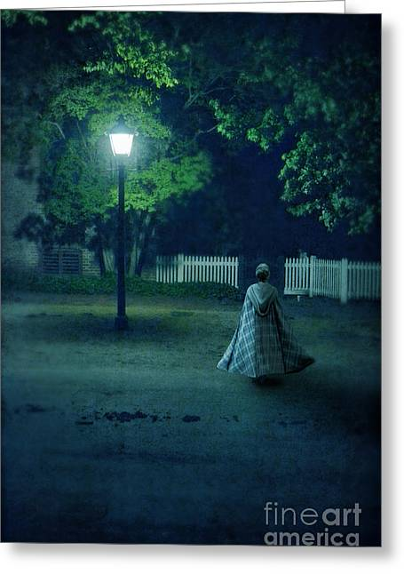 Evening Dress Greeting Cards - Lady in Vintage Clothing Walking by Lamplight Greeting Card by Jill Battaglia
