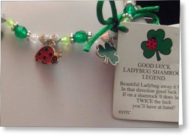 Insects Jewelry Greeting Cards - Ladybug and Shamrock Charm Bracelet with Legend Card Greeting Card by Kimberly Johnson