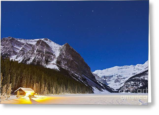 Log Cabins Greeting Cards - Lake Louise On A Clear Night In Banff Greeting Card by Alan Dyer